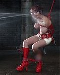 Petite redhead is dominated by latex-clad beauty and tortured by strong water jet