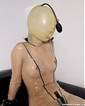 Sexy latexslavegirl in complete rubbersuit with inflatable rubbermask is bound and helpless