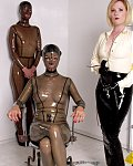 Gorgeous slavesgirls show themselves in beautiful latexdress and are dominated by cruel mistresses