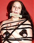 Bondage babe getting speculum in mouth and tape over ass and pussy! She is also gagged and forced to open her mouth by a dental gag